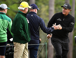 April 6, 2017 - Augusta, GA, USA - A fan reaches out to Phil Mickelson during first round action of the 2017 Masters Tournament at Augusta National Golf Club on Thursday, April 6, 2017 in Augusta, Ga. Mickelson finished the round at -1. (Credit Image: © Jeff Siner/TNS via ZUMA Wire)