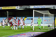 Scunthorpe United Emannuel Onariase (6) misses the target during the EFL Sky Bet League 2 match between Scunthorpe United and Bolton Wanderers at the Sands Venue Stadium, Scunthorpe, England on 24 November 2020.