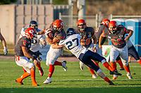 KELOWNA, BC - AUGUST 3:  Kelton Kouri #38 of Okanagan Sun is grabbed by Brody Rogers DB #27 Kamloops Broncos at the Apple Bowl on August 3, 2019 in Kelowna, Canada. (Photo by Marissa Baecker/Shoot the Breeze)