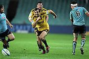 Conrad Smith kicks ahead. Waratahs v Hurricanes. 2012 Super Rugby round 15 match. Allianz Stadium, Sydney Australia on Saturday 2 June 2012. Photo: Clay Cross / photosport.co.nz