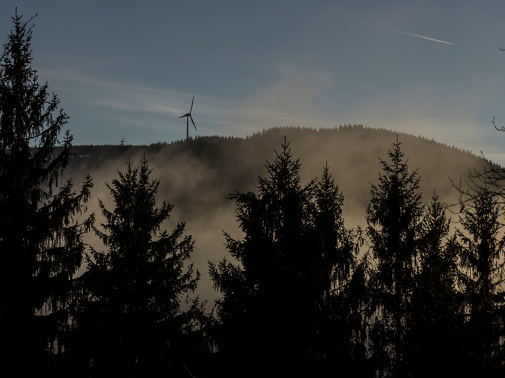 Silhouette of windmill over mountain during sunset in Black Forest, Baden-Wurttemberg, Germany