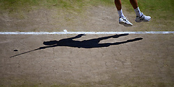 04.07.2014, All England Lawn Tennis Club, London, ENG, ATP Tour, Wimbledon, im Bild The shadow of Grigor Dimitrov (BUL) during the Gentlemen's Singles Semi-Final match on day eleven // during the Wimbledon Championships at the All England Lawn Tennis Club in London, Great Britain on 2014/07/04. EXPA Pictures © 2014, PhotoCredit: EXPA/ Propagandaphoto/ David Rawcliffe<br /> <br /> *****ATTENTION - OUT of ENG, GBR*****