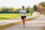Woman jogs in a park