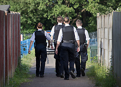 © Licensed to London News Pictures. 11/06/2018. London, UK. Police enter a play area in Northolt after a 20 year old was stabbed last night.  Another youth was stabbed in nearby Harrow. Police said a male was arrested near the scene of the stabbing in Northolt.Photo credit: Peter Macdiarmid/LNP