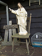 statue of Jesus placed outside on a chair