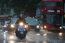 © Licensed to London News Pictures.  25/07/2021. London, UK. The Euston Road has flooded in central London as thunderstorms and heavy rainfall hit parts of London.  Photo credit: Marcin Nowak/LNP