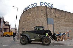 © Licensed to London News Pictures. 20/07/2012. London, UK. A member of the public looks at an army truck arriving at Tobacco Dock in East London. The base will accommodate 2,500 soldiers during the London 2012 Olympic Games.. Photo credit : Vickie Flores/LNP