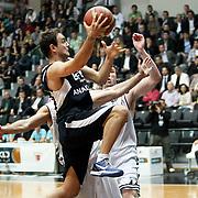 Efes Pilsen's Ender ARSLAN (L) during their Turkish Basketball league derby match Besiktas between Efes Pilsen at the BJK Akatlar Arena in Istanbul Turkey on Saturday 30 April 2011. Photo by TURKPIX