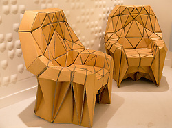 © Licensed to London News Pictures. 4/10/2013. NEC, Birmingham, UK. Grand Designs threw open it's doors today to welcome thousands of home design enthusiasts. Pictured, chairs made from cardboard. Manchester based Lazerian, used ideas from Wasps nests and the crystalline bone structure of sea based organisms Radiolaria, to form their ECO designed chairs. Photo credit : Dave Warren/LNP