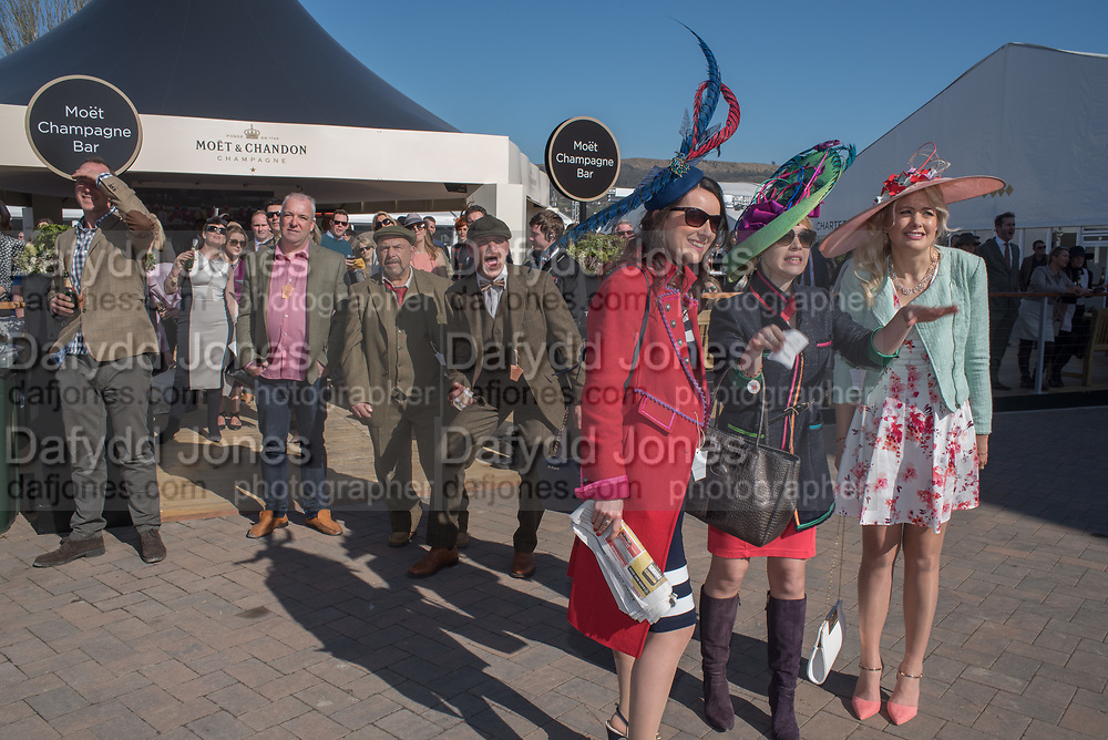 WATCHING THE RACING ON A GIANT SCREEN FROM THE CHAMPAGNE BAR, Cheltenham races,  Ladies Day, Wednesday 15 March 2017