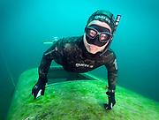 Freediver on the school bus wreck at Dutch Springs, Scuba Diving lake in Pennsylvania