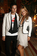 Dan Williams and Jade Jagger, launch of The Bar at the Dorchester. Park Lane. London. 27 June 2006. ONE TIME USE ONLY - DO NOT ARCHIVE  © Copyright Photograph by Dafydd Jones 66 Stockwell Park Rd. London SW9 0DA Tel 020 7733 0108 www.dafjones.com