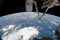 July 7, 2018 - Space - The SpaceX Dragon cargo craft is pictured berthed to the International Space Station's Harmony module still attached to the Canadarm2 robotic arm. The orbital complex was flying over the Bahamas in the Atlantic Ocean at an altitude of about 253 miles above the Earth's surface. (Credit Image: ? NASA/ZUMA Wire/ZUMAPRESS.com)