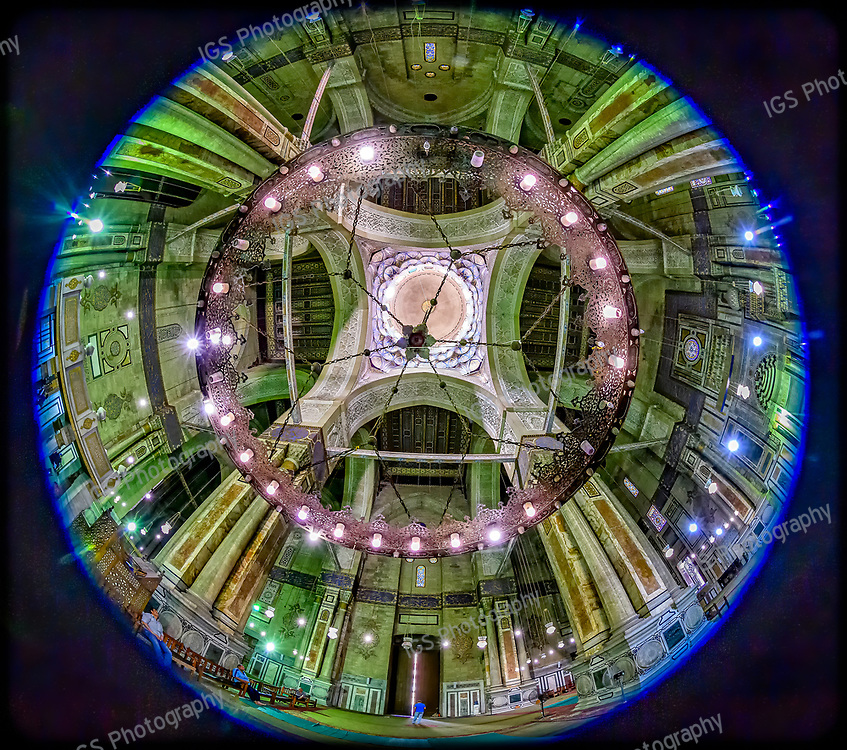 A fisheye view looking up at the dome of the Al-Rifa'i Mosque in Cairo