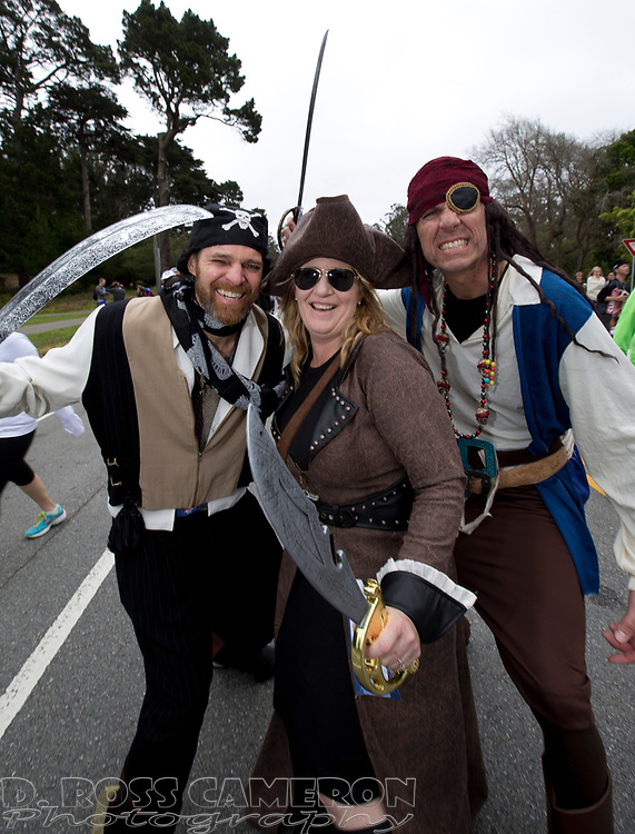 D. Pirate, from left, of Pinole, Calif., and Dawn and George Saunders of Redlands, Calif. draw their weapons during the 104th running of the Bay to Breakers 12k, Sunday, May 17, 2015 in San Francisco. Tens of thousands of runners, some clad in costume and some in nothing at all, populated the 7.42-mile route. (D. Ross Cameron/Bay Area News Group)