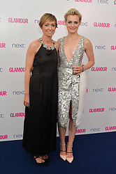 Left to right, JO ELVIN and TAYLOR SCHILLING at the Glamour Women of The Year Awards in Association with Next held in Berkeley Square Gardens, Berkeley Square, London on 3rd June 2014.