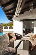 House, veranda  with garden furniture