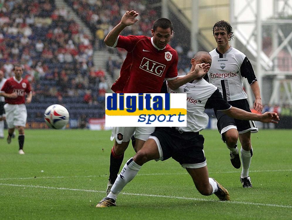 Photo: Paul Thomas.<br /> Preston North End v Manchester United. Pre Season Friendly. 29/07/2006.<br /> <br /> Phil Bardsley of Man Utd gets tackled by Jason Jarrett (R).