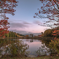 Dawn breaking over Little Long Pond in Acadia National Park, Maine.