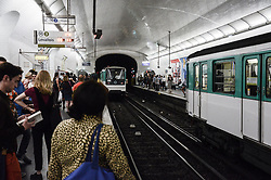 June 1, 2017 - Paris, France - A woman around 50 years old(at first look) tried to suicide herself under the metro train, only the fast reaction of an young man safe her like come down to the lines and pull her. The metro trains stopped and the situation wreak chaos at the line 4-Villiers stop, of Paris underground. A lot of people were blocked inside the metro trains and in the station more than 30 minutes, Paris, France on June 01, 2017  (Credit Image: © Hristo Rusev/NurPhoto via ZUMA Press)