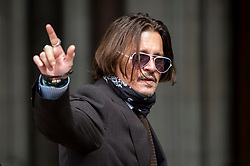 © Licensed to London News Pictures. 15/07/2020. LONDON, UK.  Johnny Depp, Hollywood actor, arrives at the High Court on day 7 of his libel case.  Mr Depp is suing The Sun newspaper's publisher News Group Newspaper, as well as executive editor Dan Wootton, for calling him a 'wife beater' in 2018. Mr Depp also that claims allegations of violence against Heard are untrue.  The case continues.  Photo credit: Stephen Chung/LNP
