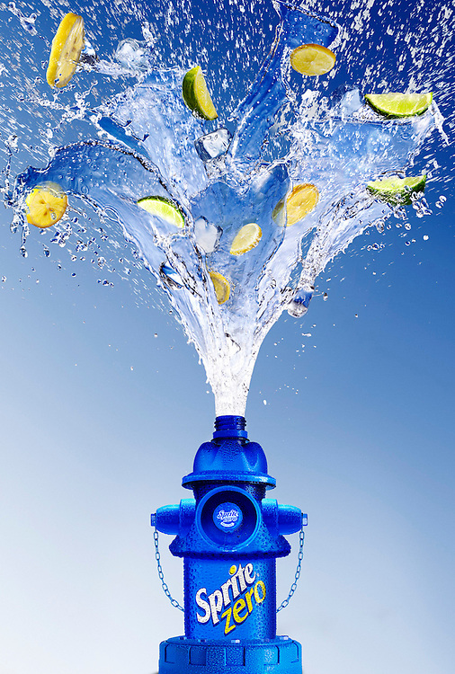 Fire Hydrant created from Sprite bottle elements with an explosion of liquid, limes and lemon Ray Massey is an established, award winning, UK professional  photographer, shooting creative advertising and editorial images from his stunning studio in a converted church in Camden Town, London NW1. Ray Massey specialises in drinks and liquids, still life and hands, product, gymnastics, special effects (sfx) and location photography. He is particularly known for dynamic high speed action shots of pours, bubbles, splashes and explosions in beers, champagnes, sodas, cocktails and beverages of all descriptions, as well as perfumes, paint, ink, water – even ice! Ray Massey works throughout the world with advertising agencies, designers, design groups, PR companies and directly with clients. He regularly manages the entire creative process, including post-production composition, manipulation and retouching, working with his team of retouchers to produce final images ready for publication.