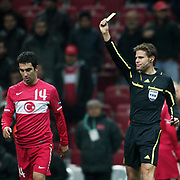 Referee's Felix BRYCH show the yellow card to Turkey's Arda TURAN (L) during their UEFA EURO 2012 Play-off for Final Tournament First leg soccer match Turkey betwen Croatia at TT Arena in Istanbul Nüovember11, 2011. Photo by TURKPIX