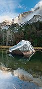 The granite monolith of Half Dome (8836 feet or 2693 meters elevation) reflects in Mirror Lake, Yosemite National Park, Sierra Nevada, California, USA. The peak rises 4737 ft (1444 m) above the valley floor. Designated a World Heritage Site by UNESCO in 1984, Yosemite is internationally recognized for its spectacular granite cliffs, waterfalls, clear streams, Giant Sequoia groves, and biological diversity. 100 million years ago, the Sierra Nevada crystallized into granite from magma 5 miles underground. The range started uplifting 4 million years ago, and glaciers eroded the landscape seen today in Yosemite. Panorama stitched from 6 overlapping photos.