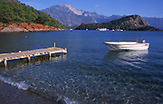 Jetty and white boat, Gemiler beach, Fethiye, Turkey
