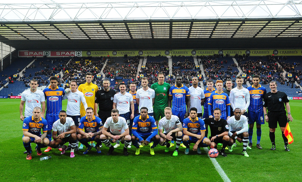 Preston North End players, Shrewsbury Town players and the match officials pose for a photograph as part the #footballremembers campaign<br /> <br /> Photographer Chris Vaughan/CameraSport<br /> <br /> Football - FA Challenge Cup Second Round - Preston North End v Shrewsbury Town - Saturday 6th December 2014 - Deepdale - Preston<br /> <br />  © CameraSport - 43 Linden Ave. Countesthorpe. Leicester. England. LE8 5PG - Tel: +44 (0) 116 277 4147 - admin@camerasport.com - www.camerasport.com