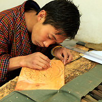 Asia, Bhutan, Thimpu. Student at the National Institute for Zorig Chusum, or traditional arts and crafts.