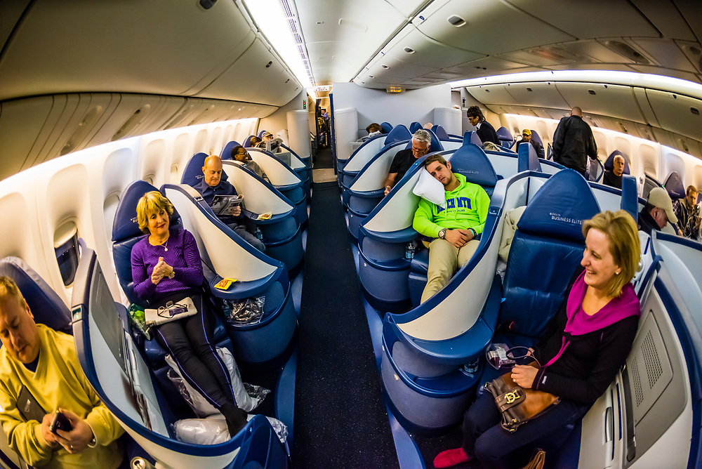 Passengers in the Business Elite cabin aboard a Delta Airlines Boeing 777-200LR settle in for the 17 hour flight from Atlanta, Georgia to Johannesburg, South Africa (the second longest nonstop flight in the world).