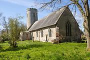 Round tower of medieval village parish church at, Ilketshall St Margaret, Suffolk, England, UK - tower c 1000 AD