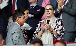 """Southampton owners Gao Jisheng (left) and Katharina Liebherr in the stands before the Premier League match at St Mary's, Southampton. PRESS ASSOCIATION Photo. Picture date: Sunday August 12, 2018. See PA story SOCCER Southampton. Photo credit should read: Andrew Matthews/PA Wire. RESTRICTIONS: EDITORIAL USE ONLY No use with unauthorised audio, video, data, fixture lists, club/league logos or """"live"""" services. Online in-match use limited to 120 images, no video emulation. No use in betting, games or single club/league/player publications."""
