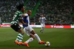 April 18, 2018 - Lisbon, Portugal - Porto's Algerian forward Yacine Brahimi (R ) vies with Sporting's forward Gelson Martins from Portugal during the Portugal Cup semifinal second leg football match Sporting CP vs FC Porto at the Alvalade stadium in Lisbon on April 18, 2018. (Credit Image: © Pedro Fiuza via ZUMA Wire)