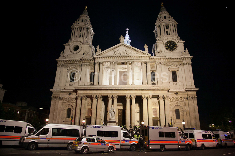 St. Paul's Cathedral by night, surrounded by police. The London Stock Exchange was attempted occypied in solidarity with Occupy Wall in Street in New York and in protest againts the economic climate, blamed by many on the banks. Police managed to keep people away fro the Patornoster Sqaure and the Stcok Exchange and thousands of protestors stayid in St. Paul's Square, outside St Paul's Cathedral. Many camped getting ready to spend the night in the square.