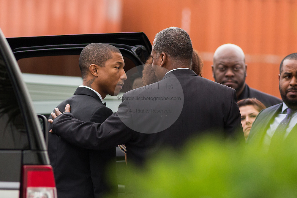Superstar Pharrell Williams thanks family members of the Charleston 9 shooting outside the historic Mother Emanuel AME Church after performing with the Gospel Choir during Sunday service November 1, 2015 in Charleston, South Carolina. The church was the site of the mass shooting that killed nine-people in June 2015 and will be featured is part of a program on race relations being produced by A+E Networks.