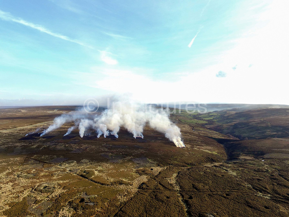 An aerial view of heather burning on the North York Moors, United Kingdom on 11th November 2017. Heather is burnt during the winter months by gamekeepers to help regenerate it. The more patches there are on the moor the better it is, producing more habitat for the grouse, and that has a knock on effect for the wader population as well