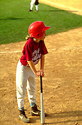 Girl age 11 waiting for her turn to bat.  St Paul  Minnesota USA