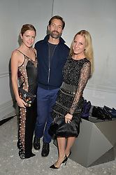 Left to right, KATIE READMAN, PATRICK GRANT and ALICE NAYLOR-LEYLAND at the Crisian London Boutique Opening at 41-42 Dover Street, London on 18th November 2014.