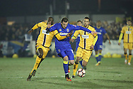 AFC Wimbledon midfielder Dean Parrett (18) battles for possesion during the The FA Cup third round replay match between AFC Wimbledon and Sutton United at the Cherry Red Records Stadium, Kingston, England on 17 January 2017. Photo by Matthew Redman.