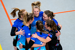 Team Zwolle with Iris Reinders of Zwolle celebrate during the first league match between Djopzz Regio Zwolle Volleybal - Laudame Financials VCN on February 27, 2021 in Zwolle.