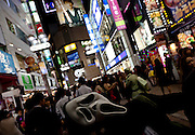 A young person dressed in a  ghost ostume to celebrate Halloween in Shibuya, Tokyo, Japan. Thursday, October 31st 2013