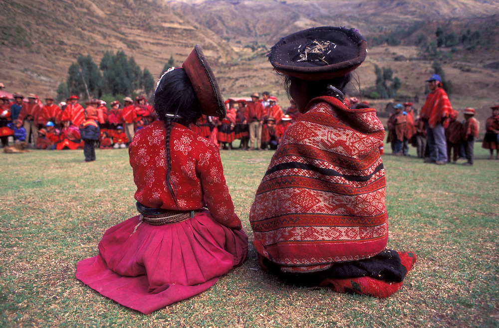Huilloc villagers in their traditional red dress on their annual day, near Ollantaytambo, Cuzco region, Peru