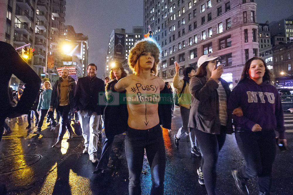 November 9, 2016 - New York, US, UK - New York, USA. A topless anti-Trump protester marches with thousands of people from Union Square to Trump Tower in New York City, on Wednesday, 9 November 2016 following the presidential election won by Donald Trump. (Credit Image: © Tolga Akmen/London News Pictures via ZUMA Wire)