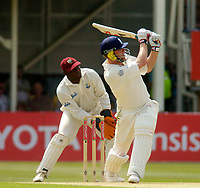Photo. Glyn Thomas. <br /> England v West Indies. Second Test, nPower Test Series.<br /> Day 2. 30/07/2004.<br /> Andrew Flintoff smashes a leg side six of Omari Banks on his way to his highest Test score of 167, as wicket keeper Ridley Jacobs (L) looks on.