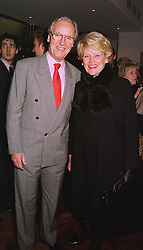 MR & MRS NICHOLAS PARSONS he is the TV presenter, at a party in London on 21st December 1998.MNB 29