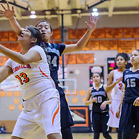 Gallup Bengal Leona Smith (13) is fouled by Miyamura Patriot Matricia Jim (34) as she drives to the hoop at Gallup High School Thursday.