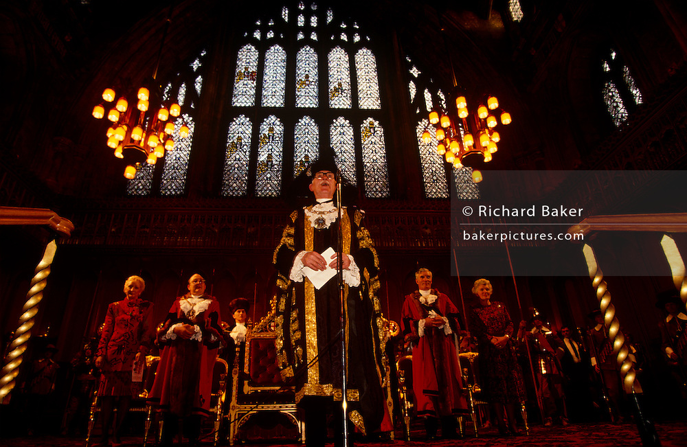 In the weeks before Christmas day in December, the Lord Mayor of London makes a speech in front of invited guests and VIPs, hosting his annual party in the Great Hall at his official town hall - the Guildhall - in the historic financial district of the City of London. Inviting Greater London's borough Mayors, they can each invite worthy children for an afternoon's fancy dress party. The Guildhall has been used as a town hall for several hundred years, and is still the ceremonial centre of the City of London. The term Guildhall refers both to the whole building and to its main room, which is a medieval style great hall similar to those at many Oxbridge colleges. The great hall is believed to be on the site of an earlier Guildhall, and has large mediaeval crypts underneath. During the Roman period it was the site of an amphitheatre, the largest in Britannia.