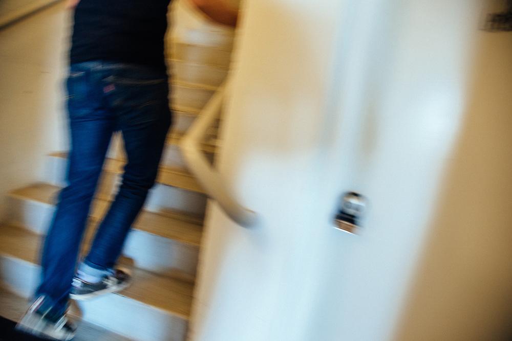 Scott Turner walks up the stairs to marketing headquarters.